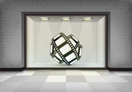 vitrine: movie tape roll in illuminated storefront vitrine concept illustration