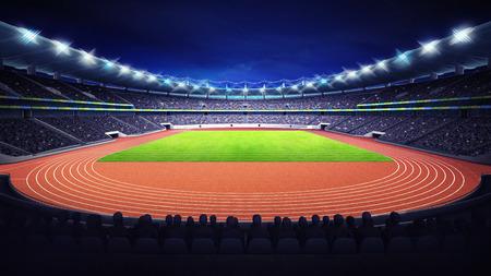 Estadio de atletismo con la pista y el campo de hierba en la noche vista frontal Foto de archivo - 43540608
