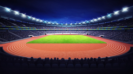 athletics stadium with track and grass field at front night view Banque d'images