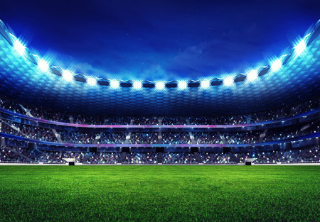 football fan: modern football stadium with fans in the stands and green grass field Stock Photo
