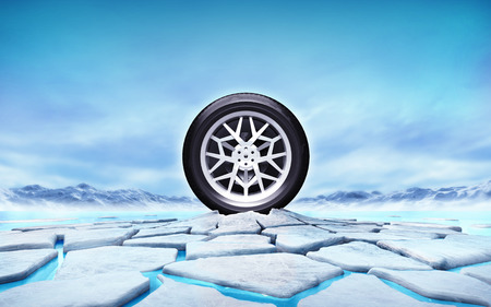 thaw: winter tire in the middle of ice floe cracked hole