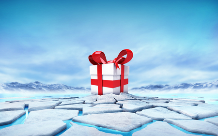 floe: gift box in the middle of ice floe cracked hole Stock Photo