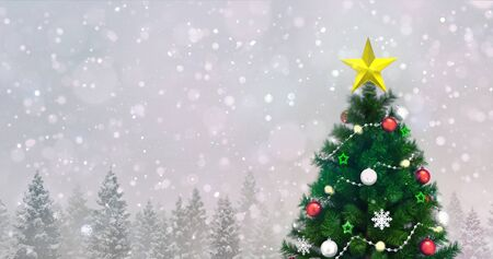 Decorated Christmas tree in winter snowy forest at snowfall, top tree closeup view Stockfoto - 134345855