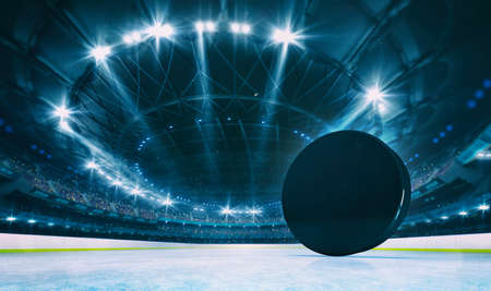 Magnificent ice hockey arena with a hockey puck on a ice rink with spectators on the grandstand. Professional world sport 3D illustration background.