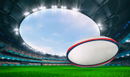 Magnificent outdoor stadium with a rugby ball on the green lawn of the field with spectators on the stands. Professional world sport 3D illustration background. Banco de Imagens