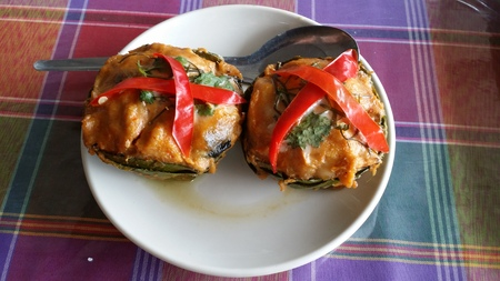 striped snakehead fish: Steamed fish curry in banana leaves at Watcharachai house Ayuttaya Stock Photo