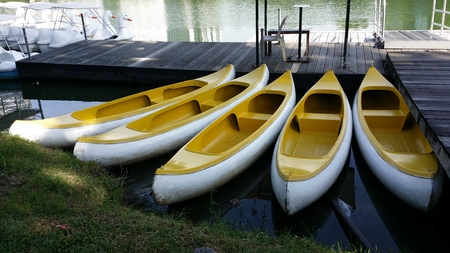 clean lungs: yellow canoes or kayaks Stock Photo