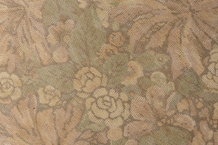 Fragment of grunge retro fabric pattern with floral rose vintage design as background. 免版税图像