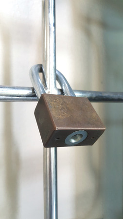 safekeeping: Padlock on a gate, security and protection