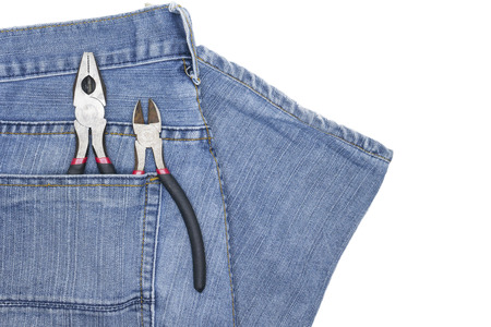artisans: Cutters, side cutters, electric cutters. In jeans pocket artisans. Stock Photo