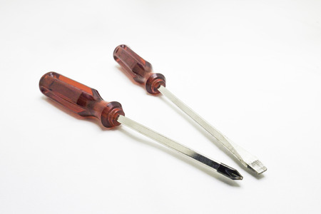 artisans: Red screwdriver artisans tools isolated on white background. Stock Photo