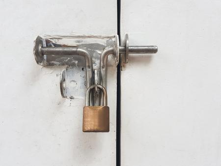 exert: Lock on a white metal gate