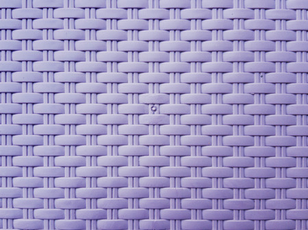 synthetic fiber: Synthetic rattan texture weaving background as used on outdoor garden furniture. Stock Photo
