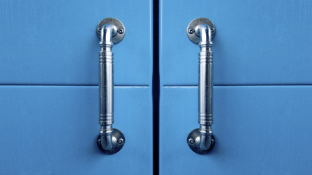 blue cabinet doors with metal handles