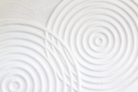 Decorative white cement wall background of abstract waves. Фото со стока