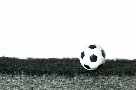Soccer ball on artificial grass, dark gray. Have a blank space for text input.