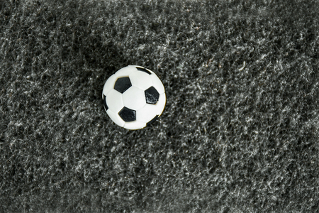 Football on artificial grass, dark gray. Have a blank space for text input. Stockfoto