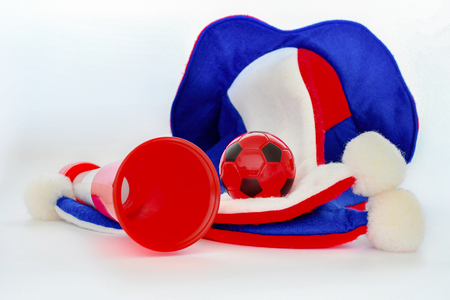 Fans hat football cheer and vuvuzela and soccer ball on white background Stock Photo