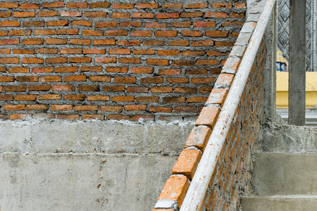 Red brick building structure is fragile. Horizontal Wide Brickwall Background.