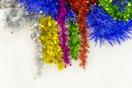 Red and golden tinsel string. Christmas decoration close up. Blank for Christmas card.