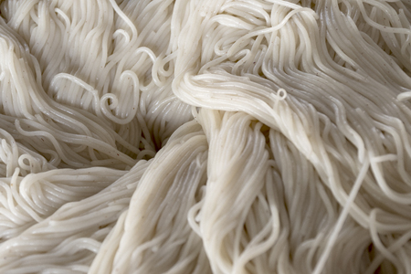 Close up lightly fermented rice noodles, usually eaten with green chicken curry. Thai rice noodle. healthy nutrients and fiber that are good for your health.
