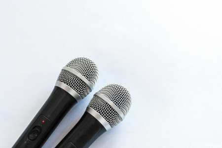 Handheld microphone for singing on white background