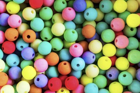 Bright colorful small ball or many colorful plastic balls. Abstract background. Sweet nice background. Color concept