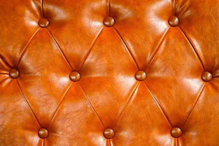 Orange leather sofa background. vintage style and geometry pattern Banco de Imagens