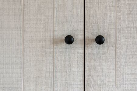 Closeup wooden cabinet  cupboard doors with handles for background