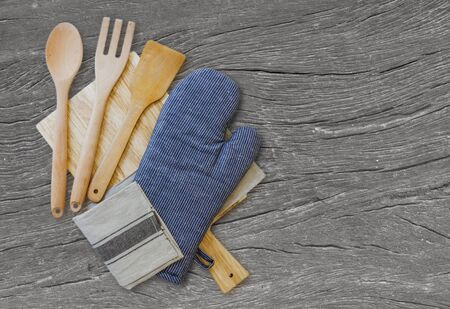 Wooden spoons and other cooking tools with blue napkins on the kitchen table. selective focus, blurred space for text
