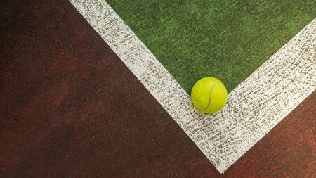Yellow tennis ball hitting the sidelines on an green and orange artificial tennis court, sport background Banco de Imagens - 131894829