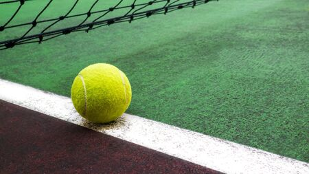 Tennis court with tennis ball close up, sport background
