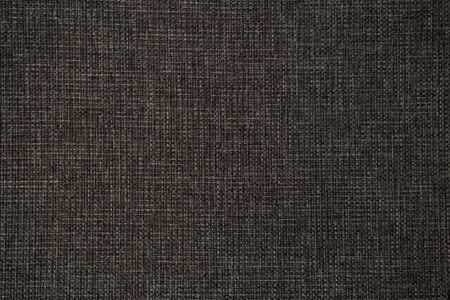 The texture of the knitted gray fabric for the background. Rough surface