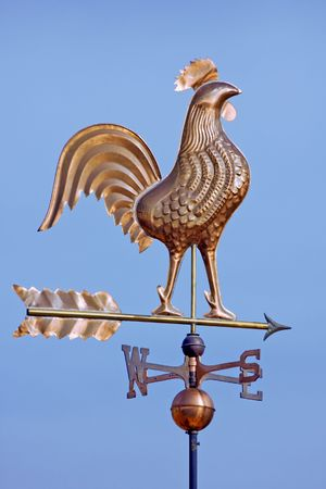 A weathercock indicates wind direction photo