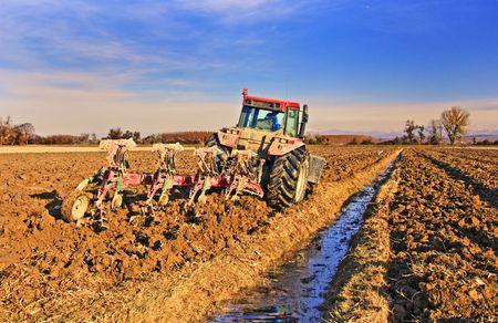 Tractor preparing the field before seeding