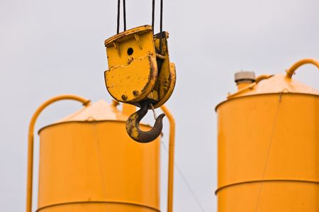 heave: Yellow hook and gravel silos in a building site