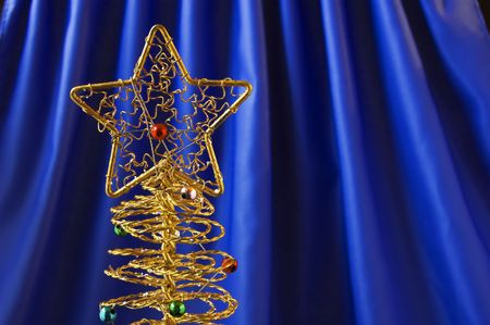 matallic: Metallic christmas tree on blue background Stock Photo
