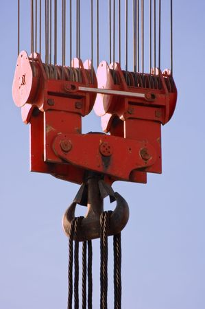 Big red hook against blue sky