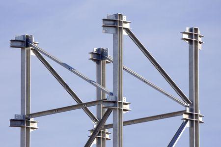 Steel framework against a blue sky Stock Photo