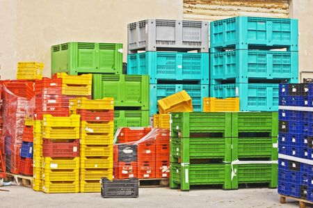 fruit trade: Coloured stacks of fruits and vegetable crates in a storehouse