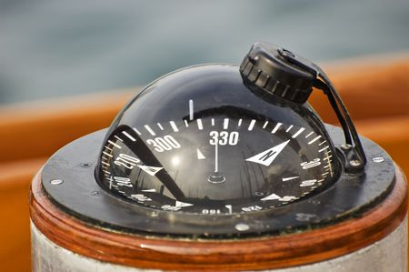 A big compass on a boat showing direction