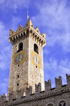 Medieval tower with clock of a caste in Trento (Italy) photo