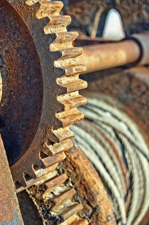 serrated: Rusty cogged wheel and of an old mechanism