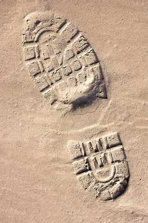 shoeprint: Shoeprint in the sand