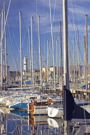 Boats moored to wharf in a harbour Stock Photo - 2442049