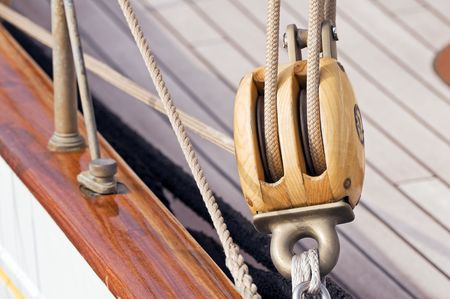 Detail of a wooden sailboat: pulley with ropes