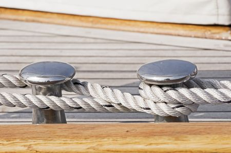 Close-up of rope securing a wooden boat to dock