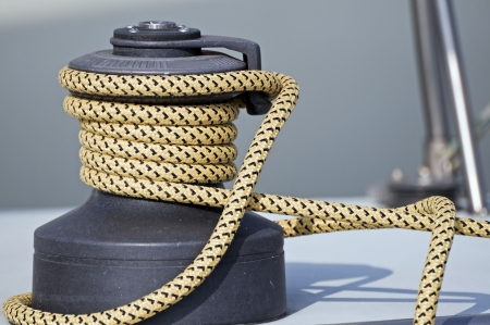 Rope rolled up on a winch in a sailboat