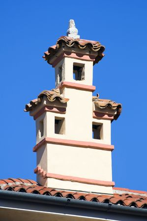 rooftiles: Close-up of a chimney against a blue sky