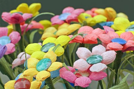 Many coloured handmade flowers made with crepe paper